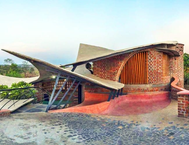 Curvaceous brick house uses passive cooling and local for Brick house construction cost